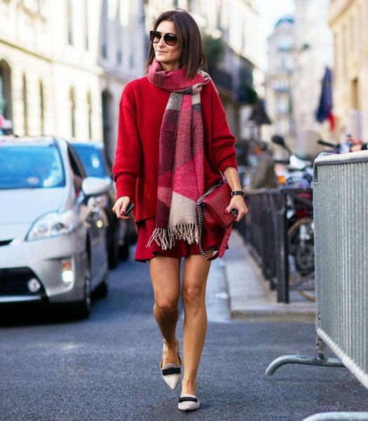 red, chunky sweater with matching miniskirt and white slippers with pointy toes