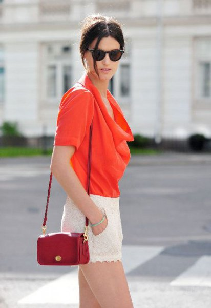 red hooded blouse with brown leather handbag