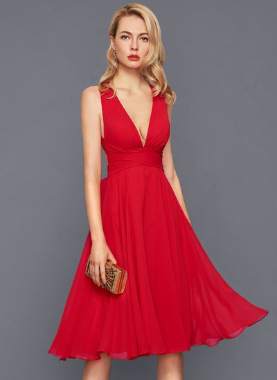 red, deep midi dress with V-neck and flared midi dress with clutch wallet