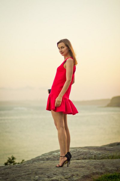 red sleeveless mini dress with fishtail and black heels