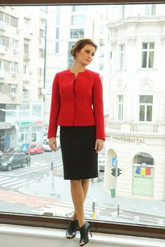 red waisted jacket with black knee-length skirt