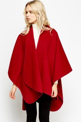 red fleece poncho with white mock neck sweater