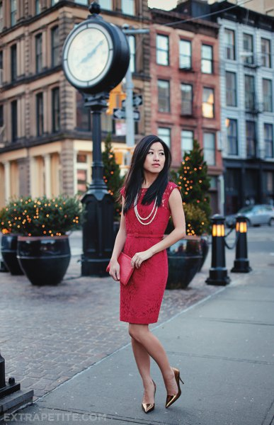 red gathered knee-length dress with sheath at the waist