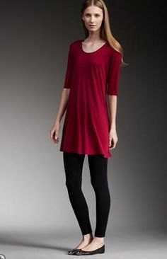 red tunic with half sleeves, black leggings and flats