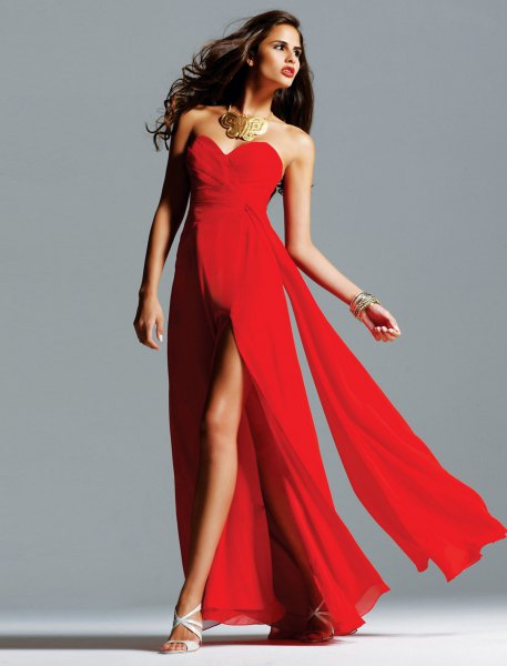 red, high-parted, floor-length dress with statement chain
