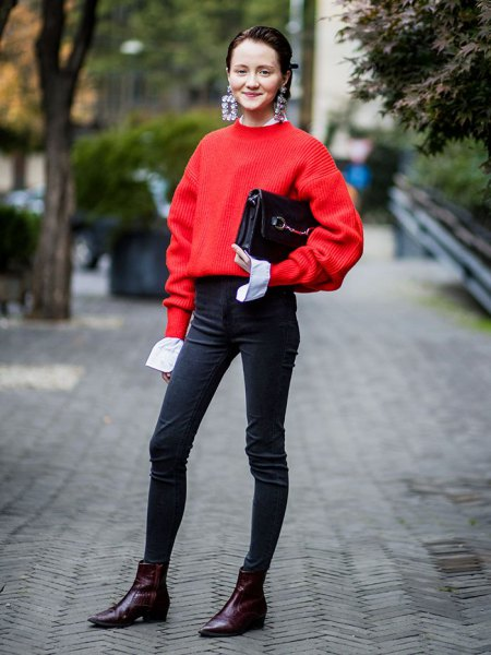 red sweater with black high-waisted skinny jeans and ankle boots