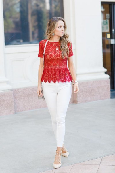 red lace top with scalloped edge and white skinny jeans