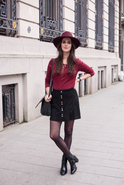 red lacing above black button in front of skirt