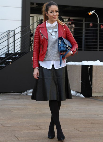 red leather jacket with gray knitted sweater and black skater dress