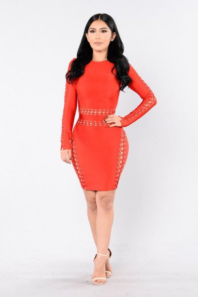 red, long-sleeved, figure-hugging dress with tiny cutouts