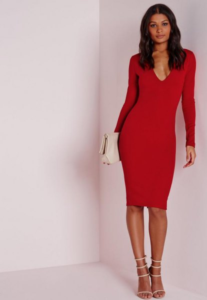 red, long-sleeved midi dress with deep V-neckline and white, open toe heels