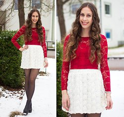 red, long-sleeved, figure-hugging lace top with white, high-waisted mini skirt