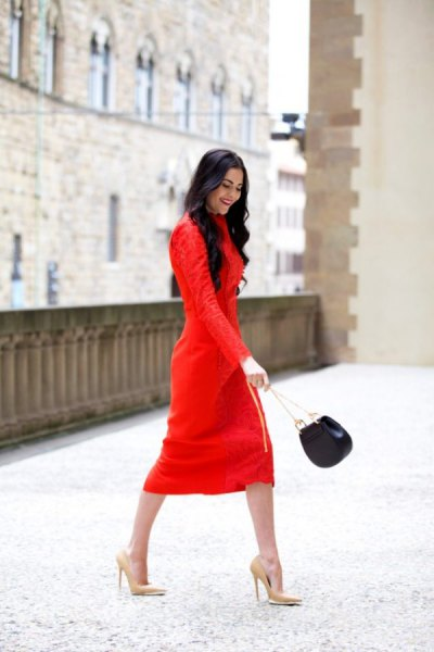 red long-sleeved midi shift dress with pink high heels with pointy toes