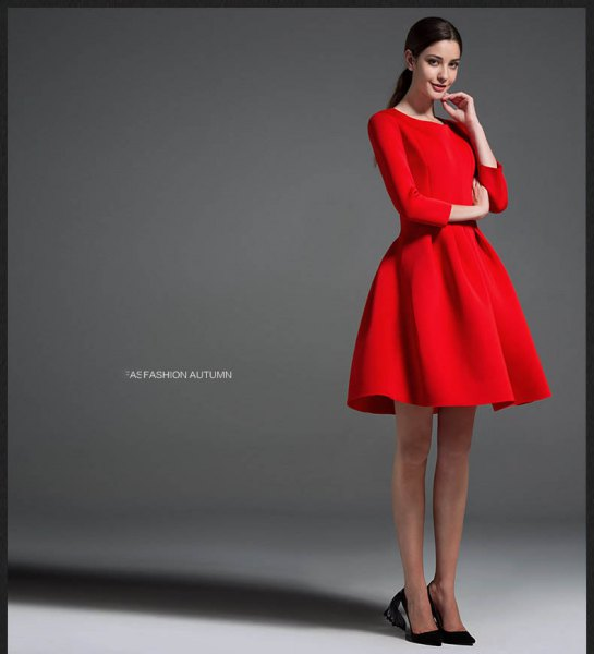 red long-sleeved mini dress with black ballerinas