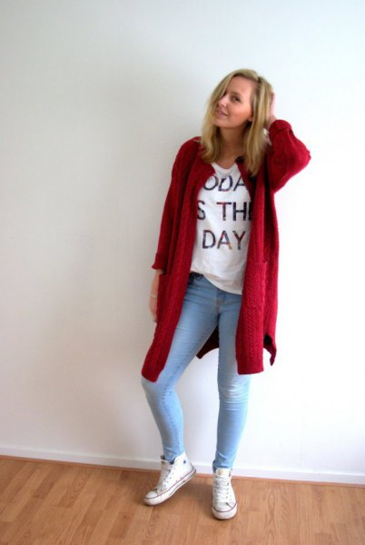 red longline cardigan with white graphic t-shirt and light blue skinny jeans