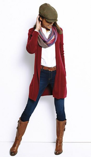 red longline cardigan with white shirt and flat hat