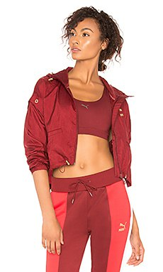 red mini bomber jacket with crop top and running shorts