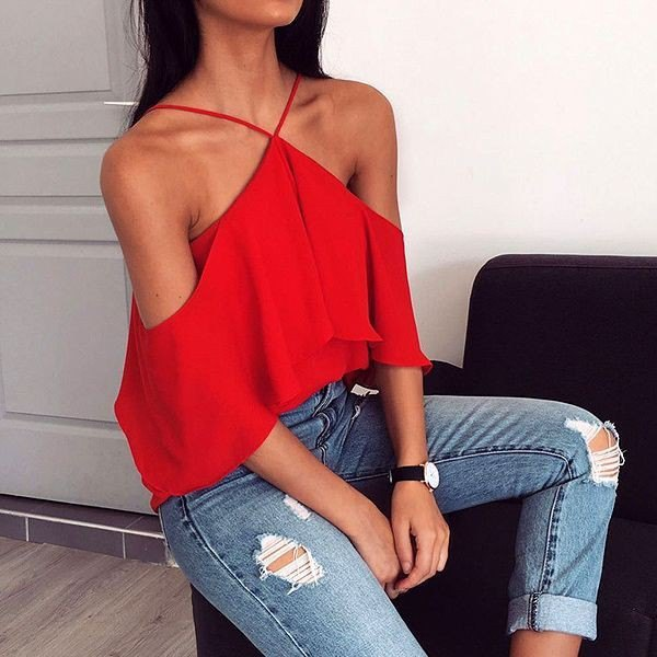 red strapless halterneck top with torn skinny jeans