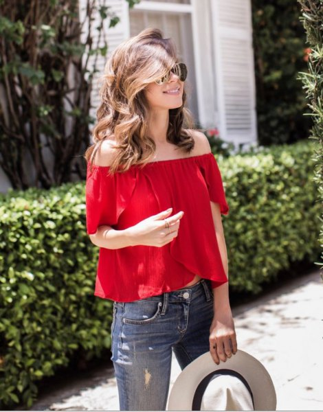 red from the shoulder blouse, white felt hat
