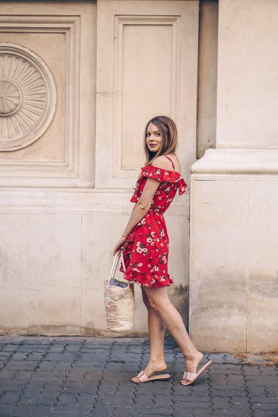 Off the shoulder, red mini dress with a floral pattern and metallic slippers
