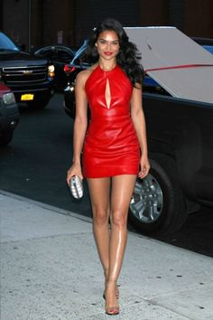 red, figure-hugging mini dress with open chest