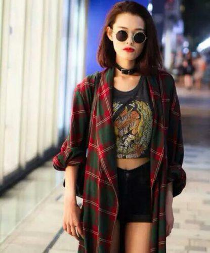 red oversized plaid flannel shirt with cropped black t-shirt and denim shorts