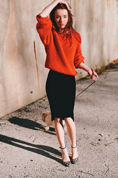 red oversized knitted sweater black pencil skirt