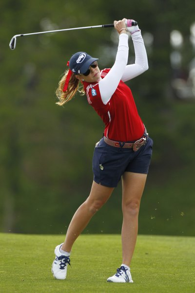 red polo shirt navy golf shorts white sleeves