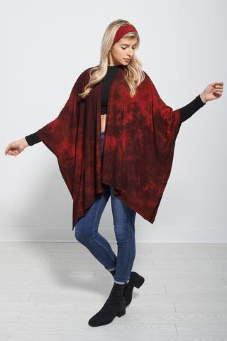 red poncho black figure-hugging long-sleeved t-shirt