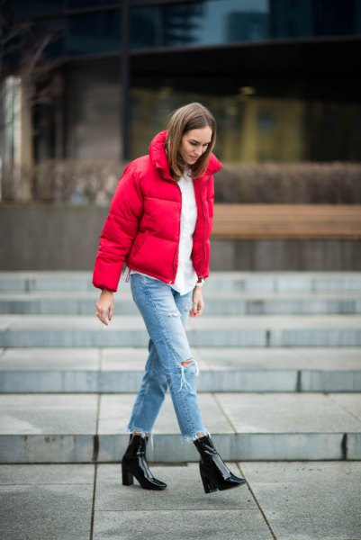 red puffer jacket with white blouse and boyfriend jeans