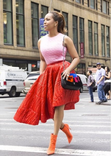 red puffer skirt with orange suede boots