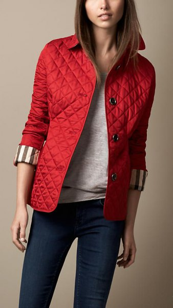 red quilted jacket, dark blue skinny jeans