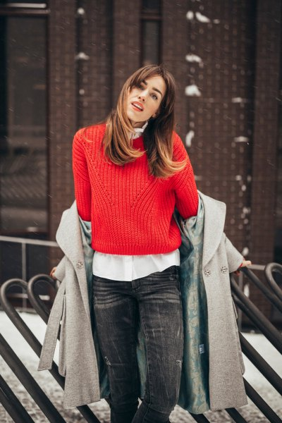 red ribbed sweater with white shirt and gray wool coat