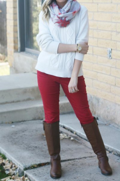 red breeches and white cable knit sweater