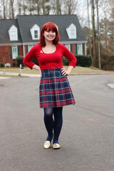 red submarine with scoop neckline and knee-length pleated skirt