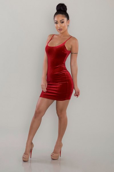 red, figure-hugging velvet dress with scoop neckline
