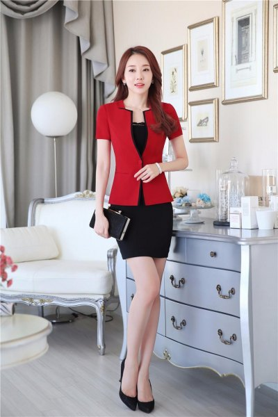 red short-sleeved blazer with black, figure-hugging mini skirt