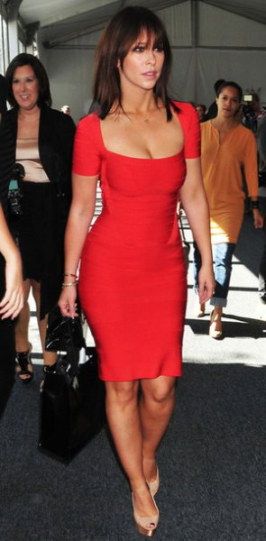 red short-sleeved, figure-hugging mini dress with a low cut