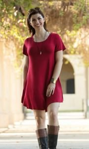 red short-sleeved tunic dress with gray knee-high boots