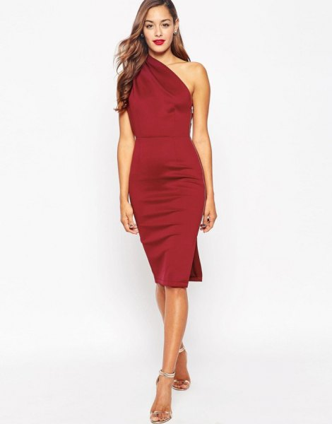 Red, figure-hugging midi skirt made of silk with silver heels