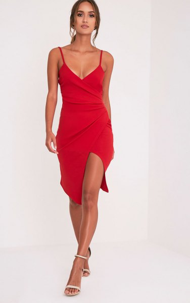 red wrap dress with deep V-neckline and spaghetti straps