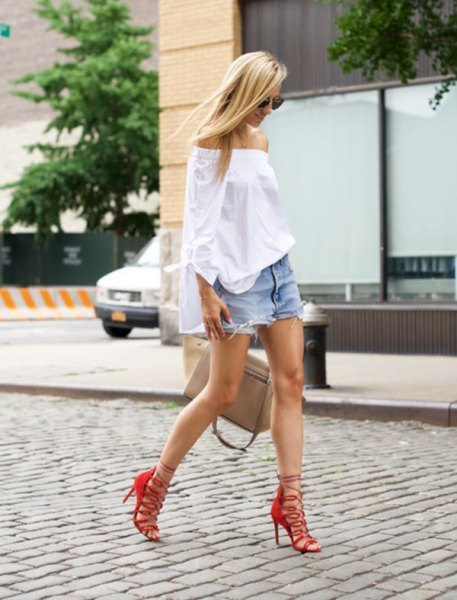 red strappy sandals and white off-the-shoulder blouse jeans shorts