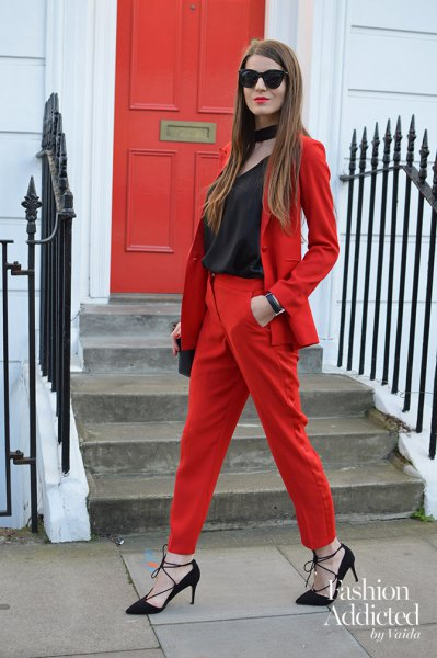 red suit with black scoop neckline and collar