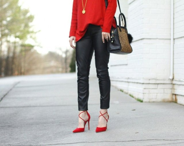 red sweater with black leather pants and strappy heels