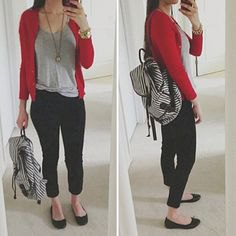 red sweater with a gray t-shirt with a scoop neckline and black, cropped jeans