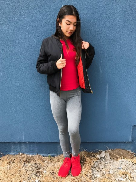 red t-shirt with black bomber jacket and gray leggings