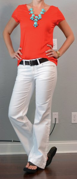red t-shirt with white flared jeans