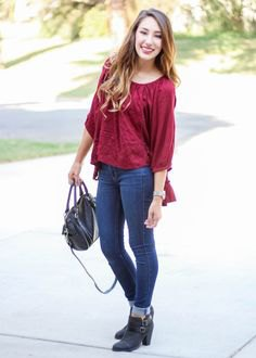 red jeans with three-quarter sleeves and blouse cuffs