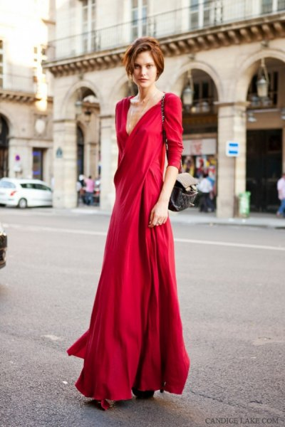 red floor-length wrap dress with three-quarter sleeves and a low cut
