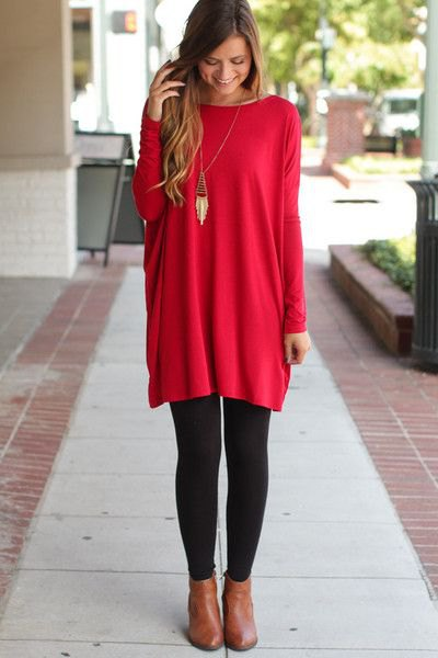 red tunic top with black leggings and boots